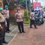 Puluhan Personil Polres Badung Mengamankan Kampanye Paslon Giriasa