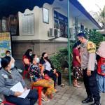 Bhabin Kerobokan Kaja Pantau Pelaksanaan Gerai Vaksinasi  Di Pustu Dalung.